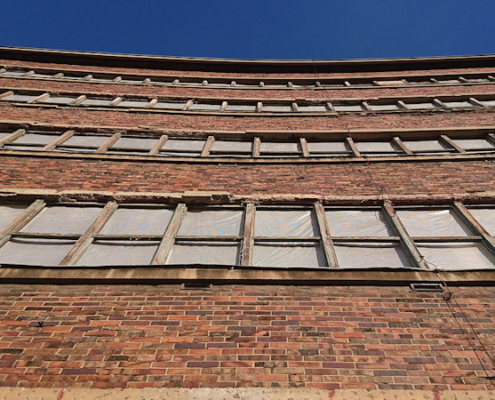 ehemalige Konsum Fleischerei Detail Fensterfront gebogen